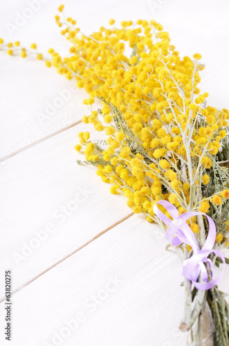 Mimosa flowers on wooden table