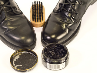 kit to polish black shoes,   polish and brush, white backgroun