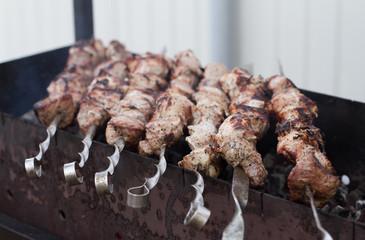 Marinated shashlik, lamb meat grilling on metal skewer