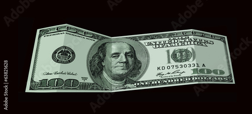 Banknote of 100 USA dollars isolated on black