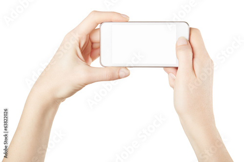 Smartphone in female hands taking photo isolated, clipping path