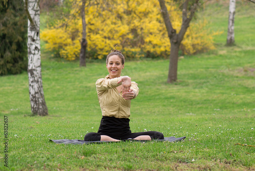 Streching girl in park and smile