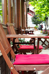 Wooden tables at the street cafe
