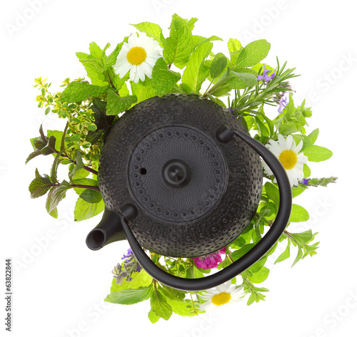 Teapot with bouquet of various herbs isolated on white