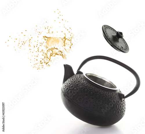 Black teapot with tea splash isolated on white background