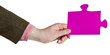 male hand holding big pink paper puzzle piece