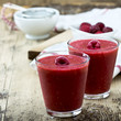 Raspberry Smoothie on rustic wooden table