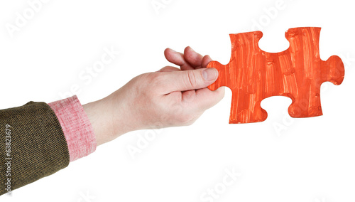 male hand with painted red puzzle piece