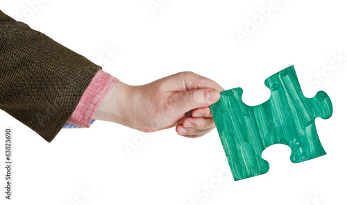 male hand with painted green puzzle piece