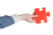 male hand holding big red paper puzzle piece