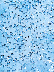 many disassembled blue puzzle pieces