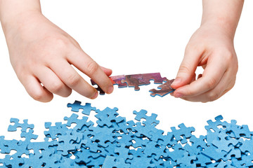 assembling of jigsaw puzzles isolated