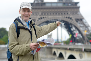 Tourist with a map in Paris