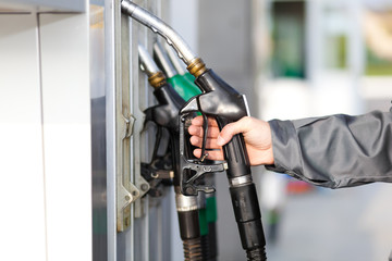 Man holding a fuel nozzle