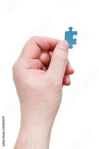 male arm with jigsaw puzzle piece