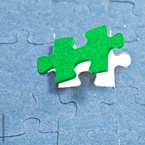 setting the last green piece of puzzle