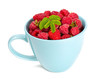 fresh raspberrie in a blue cup