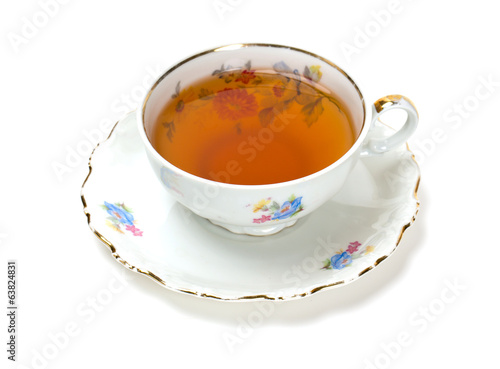 tea in vintage cup isolated on white
