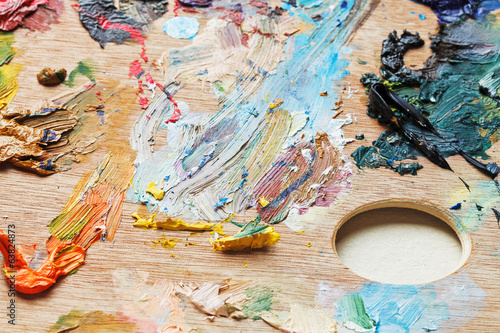 oil paint brush strokes on wooden artistic palette