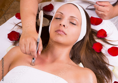 Woman getting laser and ultrasound face treatment