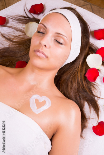 Woman with cream heart on the chest.