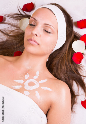 Woman with cream sun on the chest.