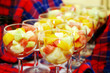 Delicious fresh fruits in glass bowls