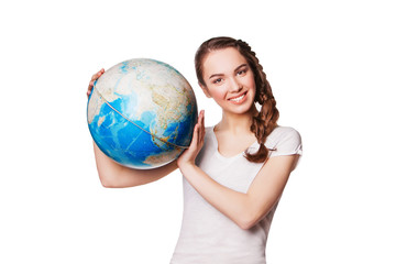 Pretty smiling young lady holding a world globe