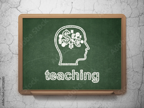 Education concept: Head With Finance Symbol and Teaching