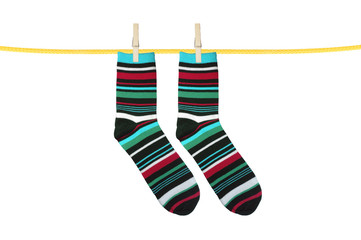 Striped socks hanging isolated on white