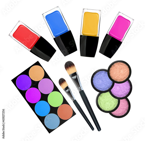 set of 5 eyeshadows, brushes and nailpolishes isolated on white