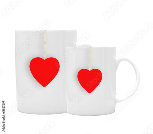 White tea cups with red tealabel isolated on white background