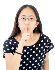 Tween Girl With a Silence Gesture