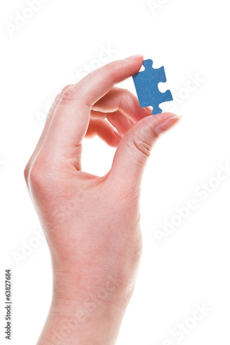 female arm with jigsaw puzzle piece