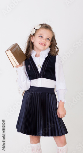 girl holds book