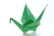green paper origami bird on a white background