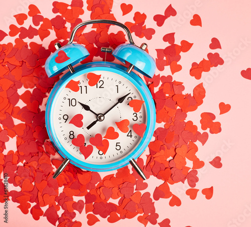Alarm clock covered with red heart