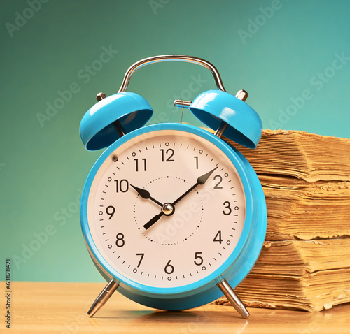 Alarm clock and old books