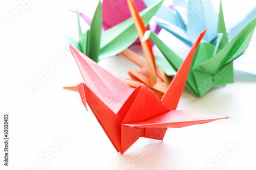 colorful paper origami birds on a white background