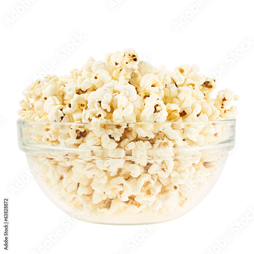 Glass bowl full of popcorn isolated