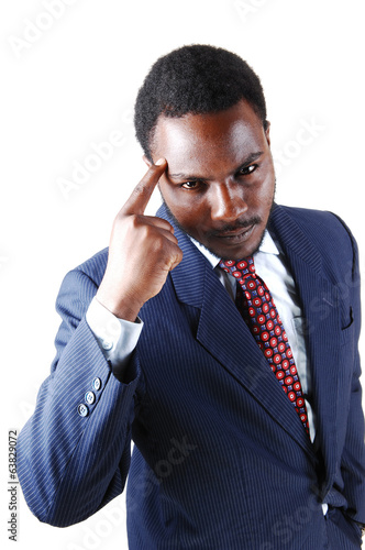 Black man with finger on head.