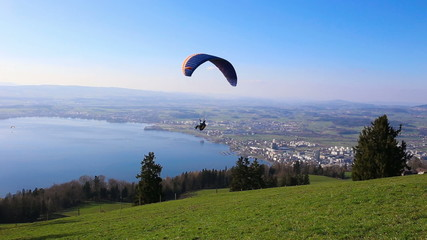 Paraglider over the Zug city, Zugersee and Swiss Alps