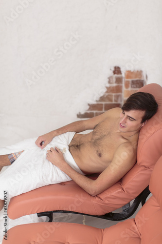Young man relaxing in the salt room