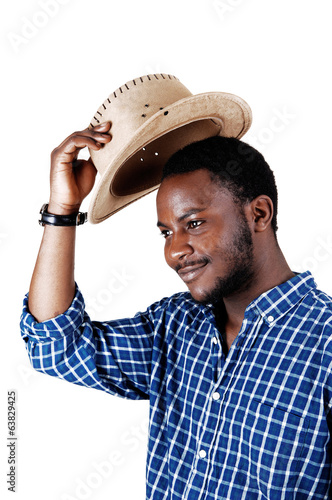 Black man lifting his hat.