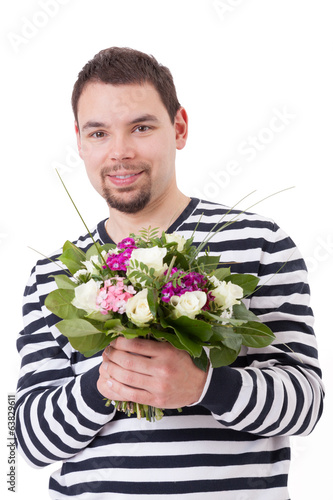 Smiling man with bouquet of flowers