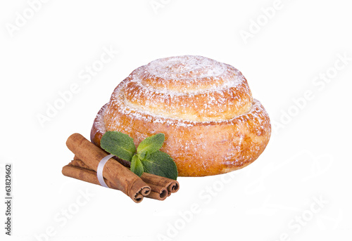 bun with powdered sugar, cinnamon and mint on a white background