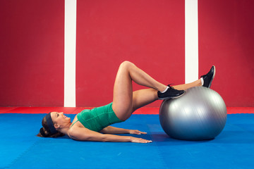 Fitness woman exercising with  ball in gym