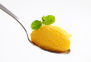 Yellow ice cream on spoon