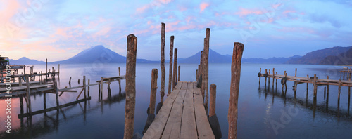 Fotobehang Vulkaan Pier on the Atitlan Lake in Guatemala at Sunrise