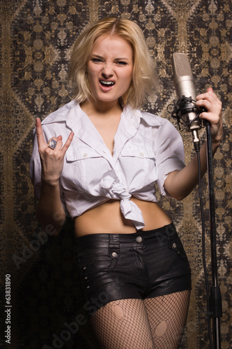 Rock babe singing into a microphone